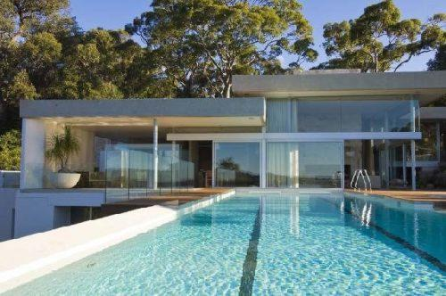 walker house pool Casas de diseño: Casa Walker